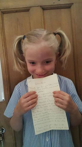 Whizz Pop Bang reader with the handwritten reply from her local MP