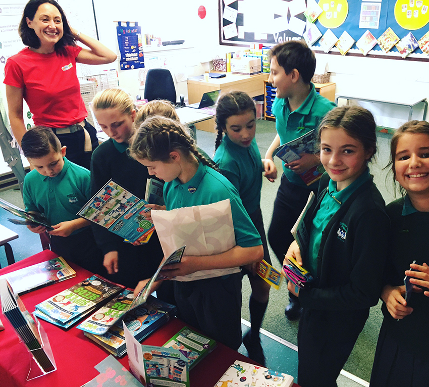 Pupils choosing science magazines