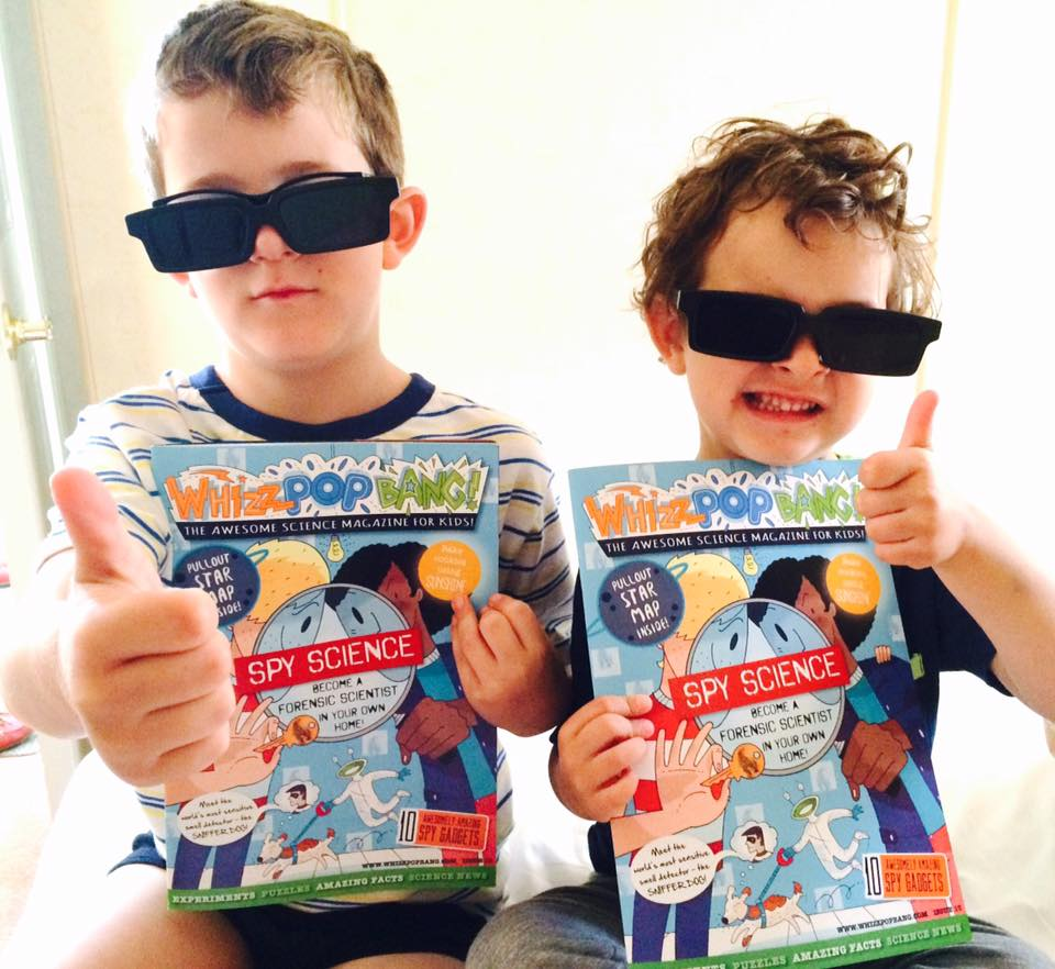 Boys with their SPY issue of Whizz Pop Bang science magazine for kids